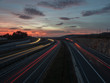 the light trail of a moving vehicles views during sunset hour