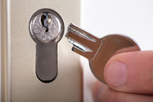 Man Holding Broken Key