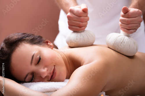 Therapist Giving Massage With Herbal Compress Balls To Woman Canvas Print