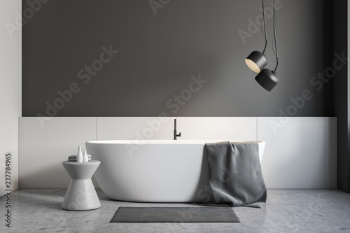 Gray and white bathroom interior, white tub