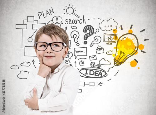 Obraz Little boy in glasses, business plan - fototapety do salonu