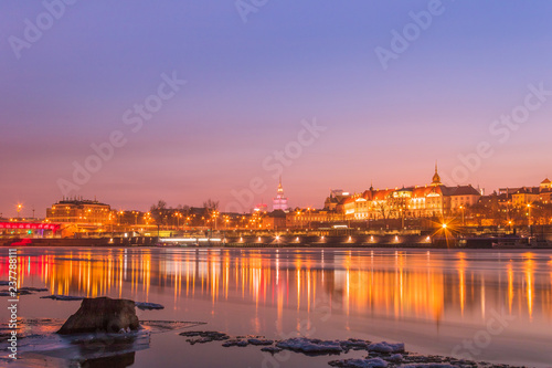 Wall Murals Temple Warsaw skyline with reflection in the Vistula river in the evening