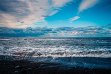 Blue Sea And Cloudy Sky Waves