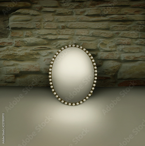 Montage in der Fensternische Surrealismus Small mirror with vintage frame decorated in pearls resting on a floor and with brickwall background