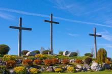 Three Crosses Against A Bright Blue Sky