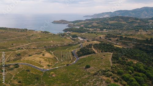 Foto op Aluminium Khaki Cars go on a serpentine through the mountains and beaches, shooting from a drone
