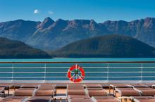 Empty Cruise Ship Lounge Chairs And Life Ring, Lido Deck. Alaska, USA.