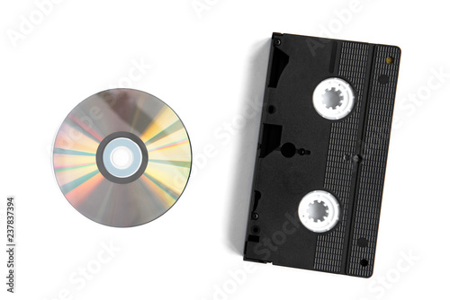 Valokuva  Videocassette and disc isolated on white background.
