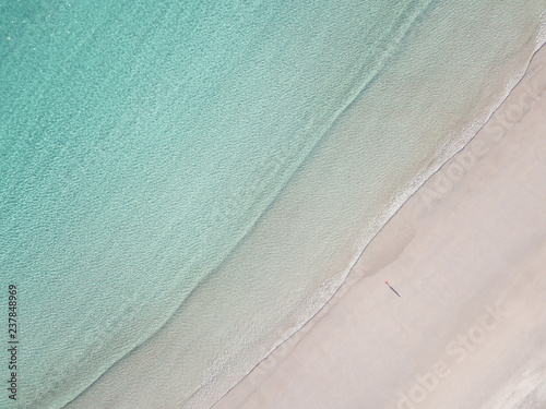 High angle view of lonely man on the Lofoten beach with copy space