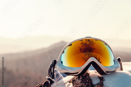 obraz dibond ski goggles on the snow