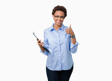 Young African American Businesss Woman Holding Clipboard Over Isolated Background Happy With Big Smile Doing Ok Sign, Thumb Up With Fingers, Excellent Sign