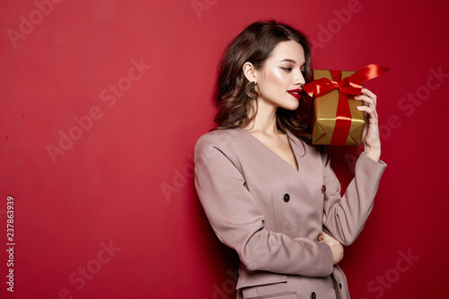 Sexy pretty lady fashion model beautiful woman wear style dress celebration happy holidays merry Christmas Eve New Year party hold gift box present surprise brunette makeup St. Valentine's Day.