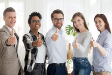 Happy Millennial Multiracial People Standing Together Showing Thumbs Up Sign, Smiling Young Employees Or Workers Make Gesture Recommending Good Service, Diverse Colleagues Give Recommendation