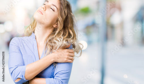 Cadres-photo bureau Jogging Beautiful young blonde business woman over isolated background Hugging oneself happy and positive, smiling confident. Self love and self care