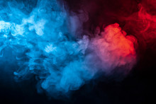 Clubs Of Isolated Colored Smoke: Blue, Red, Orange, Pink; Scrolling On A Black Background In The Dark Close Up.