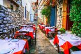 Fototapeta Uliczki - traditional colorful Greece series - cute taverns in narrow streets. Skiathos island