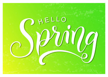 Modern Calligraphy Lettering Of Hello Spring In White With Shadow On Yellow Green Textured Background For Decoration, Greeting Card, Poster, Banner, Sticker, Postcard, Calendar