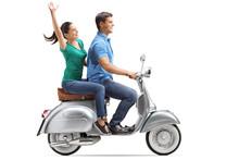 Young Couple Riding On A Vinta...