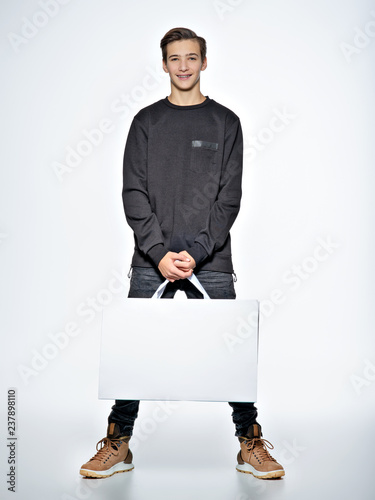 e8f909a78 Teen boy with shopping bags at studio. - Buy this stock photo and ...