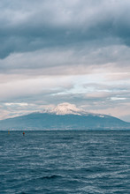 Mount Vesuvius Covered In Snow, Seen From Sorrento, Italy