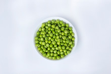 Green Peas In A Bowl Isolated On White