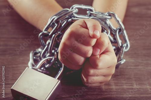 Obraz na płótnie Children with chain tied, imprison, retarded, Child concept