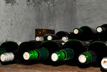 Wine Vault. Nice Composition Of Wine Glass On A Wooden Table.