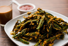 Kurkuri Bhindi Or Crispy Ladyfinger Or Okra Fry Recipe, Served In A Bowl With Ketchup And Hot Tea. Selective Focus
