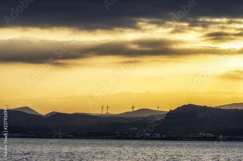 Fotobehang Zwavel geel Sunset view of Jeju from Udo