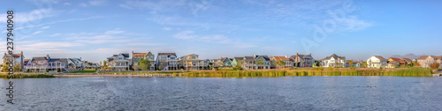 Obraz Panoramic view of Oquirrh Lake with homes and sky - fototapety do salonu