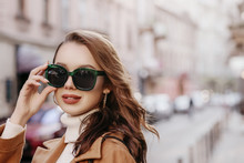 Outdoor Close Up Portrait Of Young Beautiful Woman Wearing Big Stylish Green Sunglasse, Model Walking In Street. Copy, Empty Space For Text