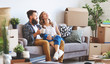 canvas print picture - happy young married couple moves to new apartment