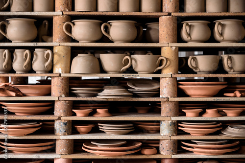 Canvas-taulu crafted pottery in portugal, still life of hand made pottery and ceramic bowls