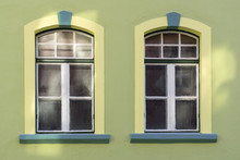 Two Windows On  A Green Wall