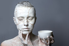 Portrait Of A Woman Holding White Cup Isolated Over White
