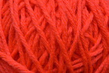 A Close Up Of A Orange Ball Of Yarn