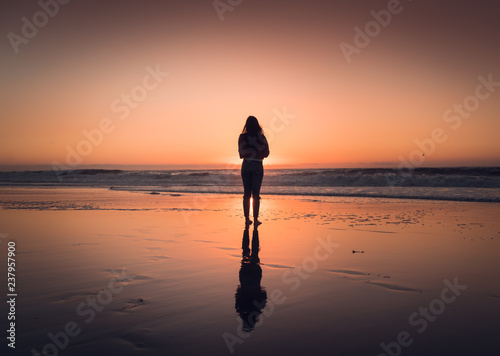 Foto op Plexiglas Cappuccino silhouette of woman at sunset in Redondo Beach California right outside of Los Angeles