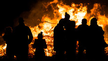 Silhouette Of People In Front Of Bonfire