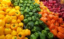 Heap Of Bell Peppers On The Shelf Of A Supermarket Or Grocery Store. Colorful Shiny Vegetables. Green, Purple, Yellow And Orange Bell Peppers.