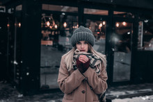 Cute Girl In A Warm Hat Trying To Keep Warm