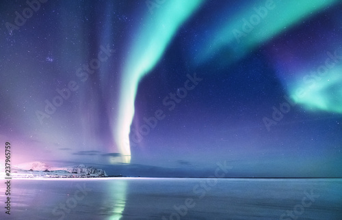Foto auf Gartenposter Nordlicht Aurora borealis on the Lofoten islands, Norway. Green northern lights above mountains. Night sky with polar lights. Night winter landscape with aurora. Natural background in the Norway