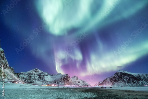 Poster Aurore polaire Aurora borealis on the Lofoten islands, Norway. Green northern lights above mountains. Night sky with polar lights. Night winter landscape with aurora. Natural background in the Norway