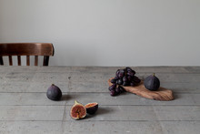Figs And Black Grapes Still On The Table With Chair