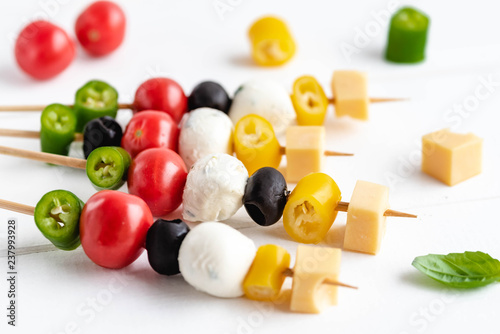 Fotografia  Appetizer on stick with various vegetables and cheese.