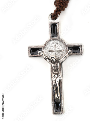 Fotografering Rosary crucifix detail, cross isolated on white background.