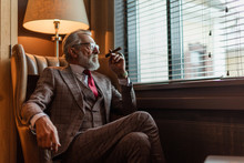 Serious Old-aged Businessman W...