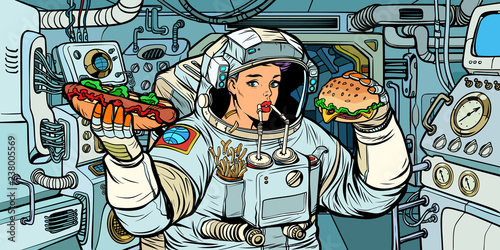 Photo  Woman astronaut eats in a spaceship