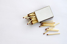Open Cardboard Matchbox Filled With Matches On A White Background. Flat Lay Minimal. Top View With Text Space