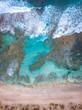 Waves crashing against coastline