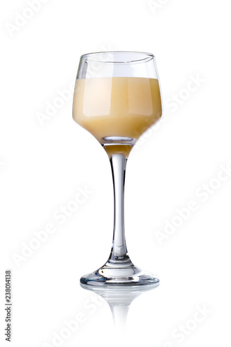 glass of cream liqueur isolated